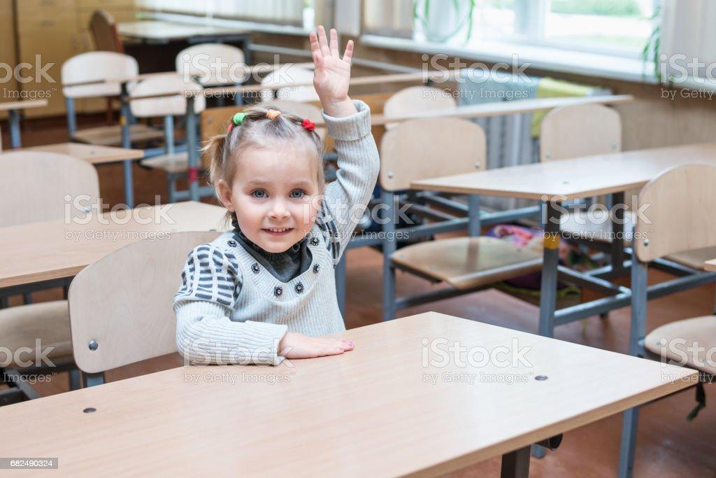 Child raises his hand royalty-free stock photo