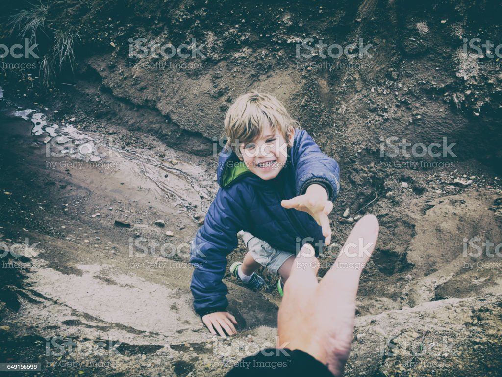 Child reaching for help stock photo