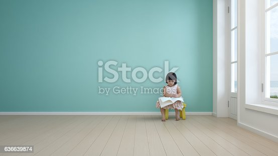 istock Child reading book in kids room of modern beach house 636639874