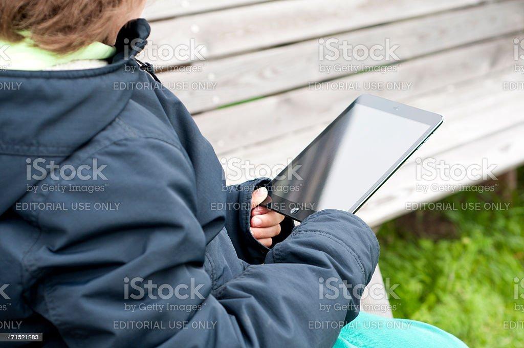Child reading on iPad mini royalty-free stock photo