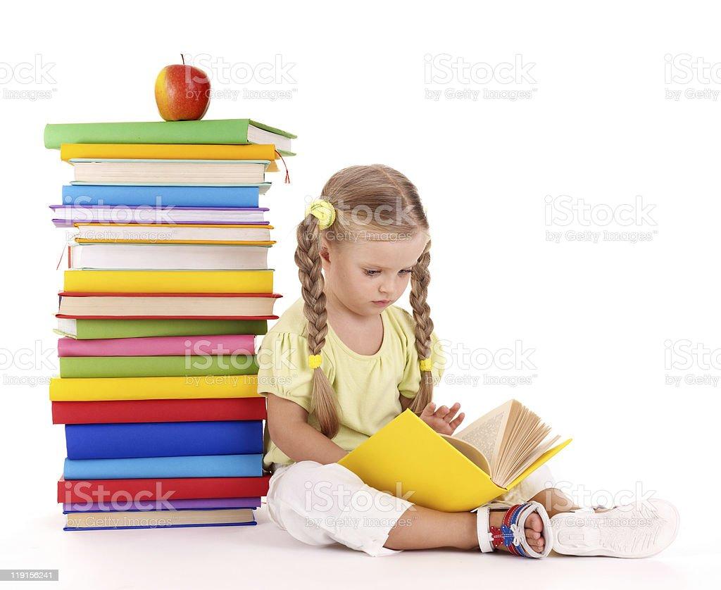 Child reading  pile of books. stock photo