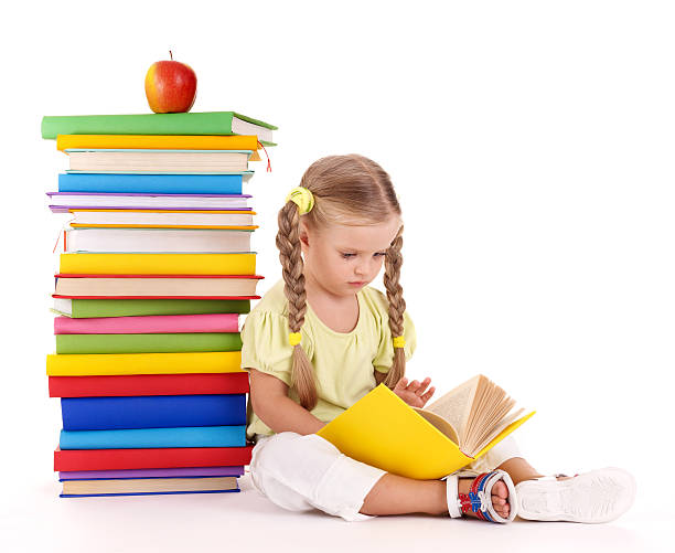child reading  pile of books. - pigtails stock photos and pictures