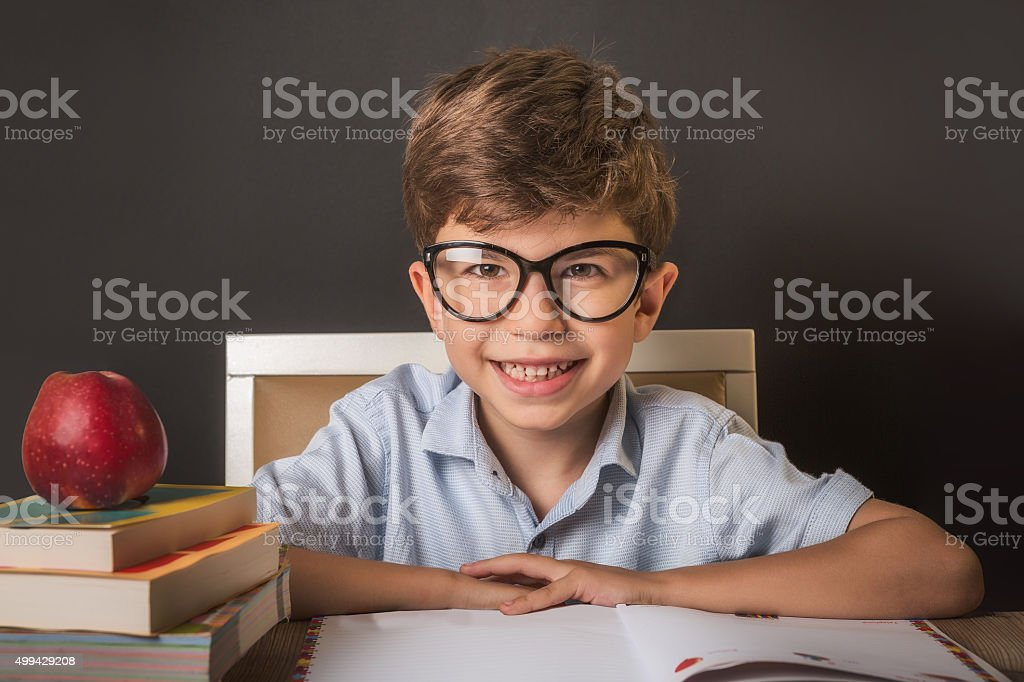 Child reading pile of books. stock photo