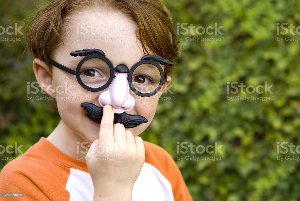 Child Redhead Boy, Disguise & Glasses Picking Nose, Halloween Costume stock photo