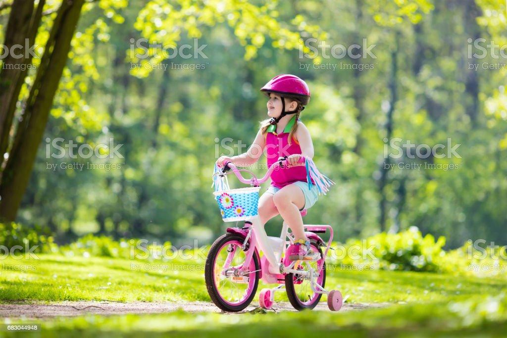 Child riding bike. Kid on bicycle. royalty-free stock photo