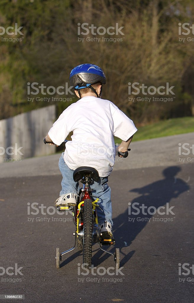 Child Riding Bike stock photo