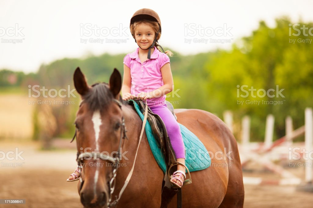 Child Riding Horse Outdoors. stock photo