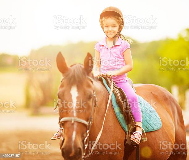 Child riding horse outdoors picture id459037157?b=1&k=6&m=459037157&s=612x612&h=wbgrvfaipejlo5iuy ugeyoqglrdkqtcoswmmjw5olk=