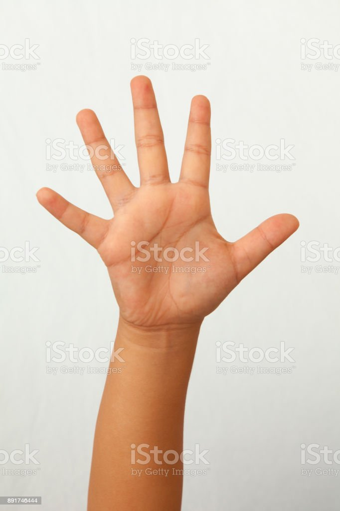 Child right hand palm on white background stock photo