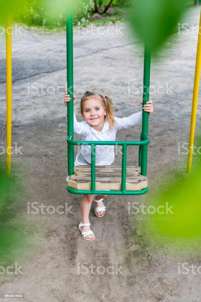 Child rocking swing royalty-free stock photo