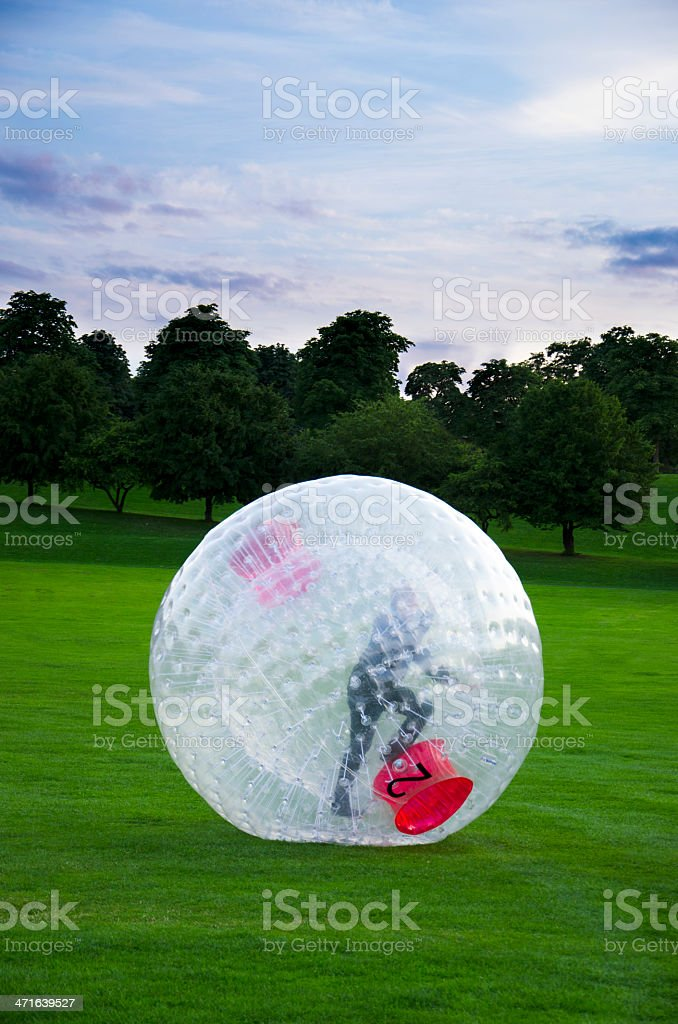 Child Rolling Inside Large Plastic Ball stock photo