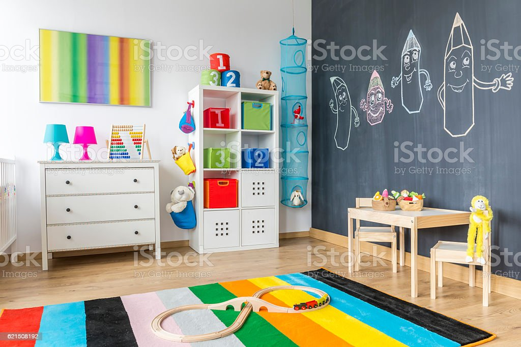 Child room with colorful rug Lizenzfreies stock-foto