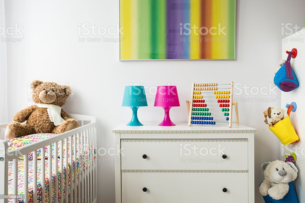 Child room with cradle, chest of drawers foto stock royalty-free