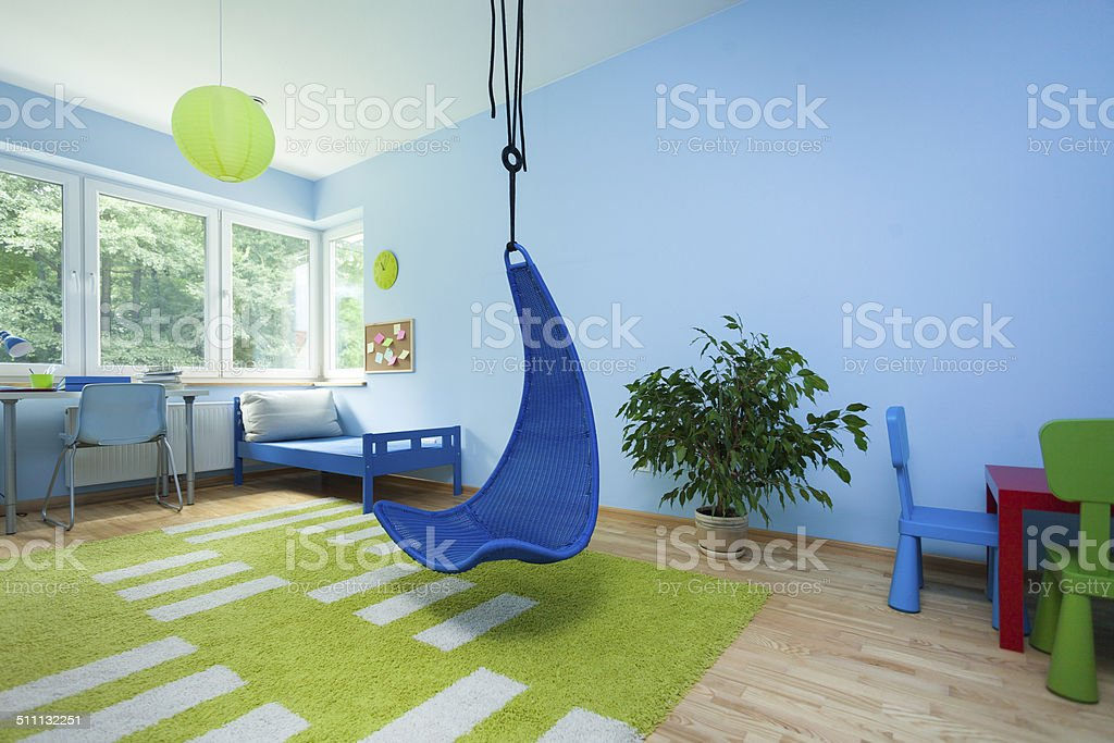 Child room with hanging chair Interior of child room with hanging chair Apartment Stock Photo