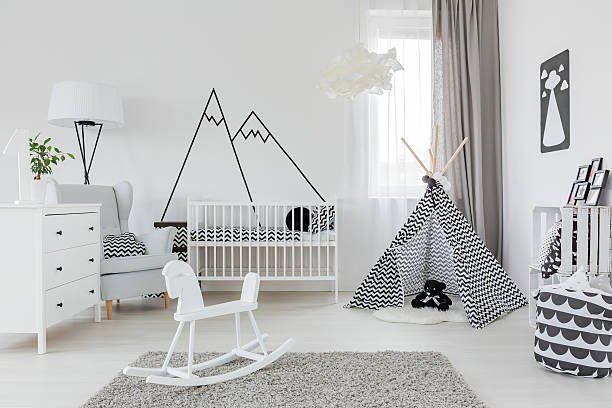 Child room with white furniture stock photo
