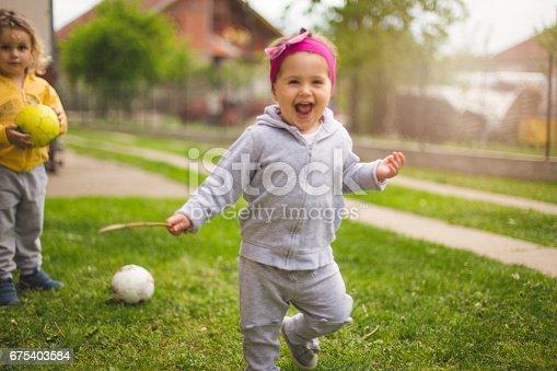 678589610istockphoto Child running and smiling 675403584