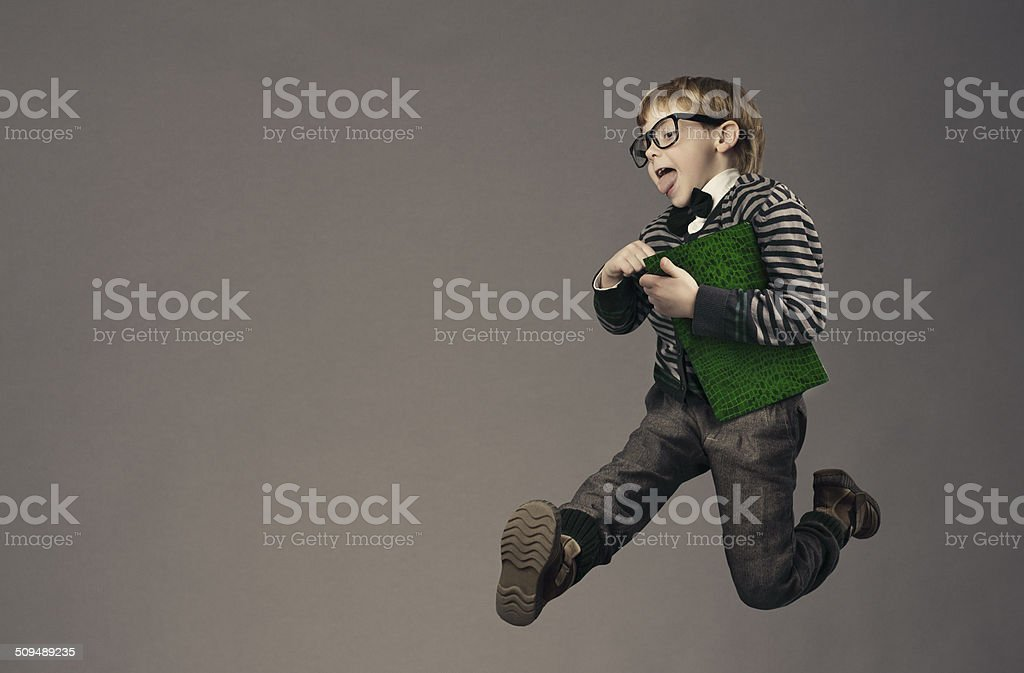 child running back to school, funny kid, jumping smart schoolboy stock photo
