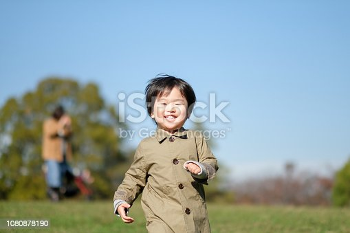 589135214 istock photo Child running in park 1080878190