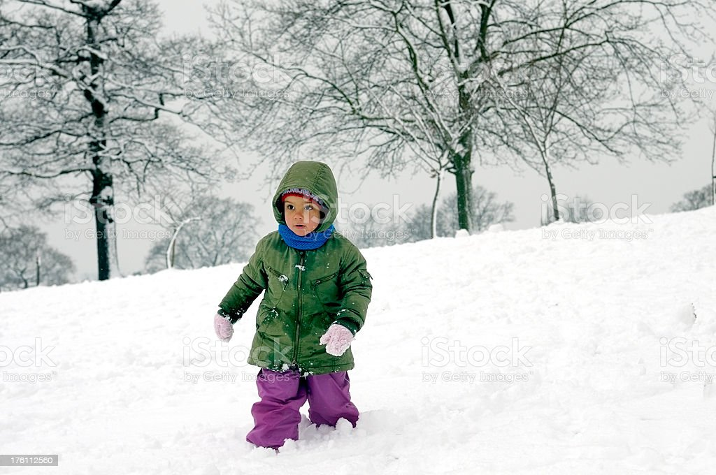 Child running in snow royalty-free stock photo
