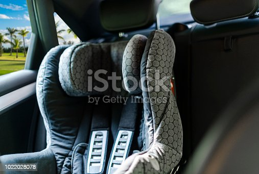 istock Child safety seat in the back of the car. Baby car seat for safety. Car interior. Car detailing 1022028078