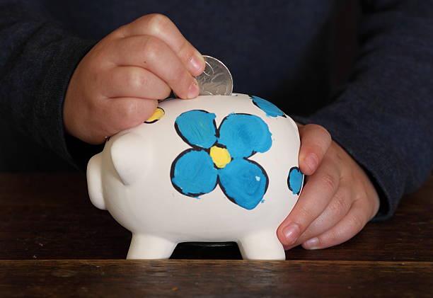 Child saving money stock photo