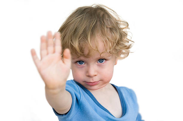 Child saying no Child saying no. Toddler lifting hand in protest isolated on white background. stop single word stock pictures, royalty-free photos & images