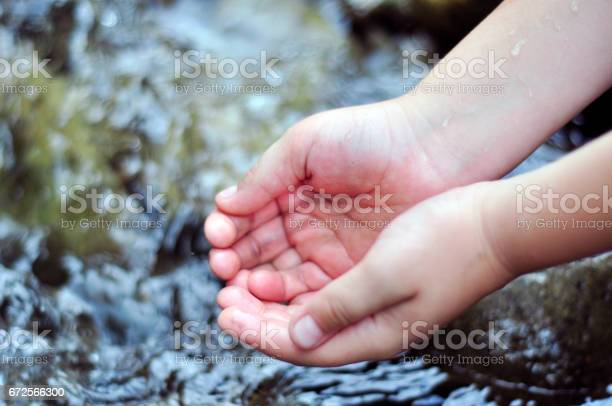 Child scoops up clear water with his hands in river picture id672566300?b=1&k=6&m=672566300&s=612x612&h=wp lvry96ilu8n4wqv1bcgwtpv36hbpsud7kjgizkdc=