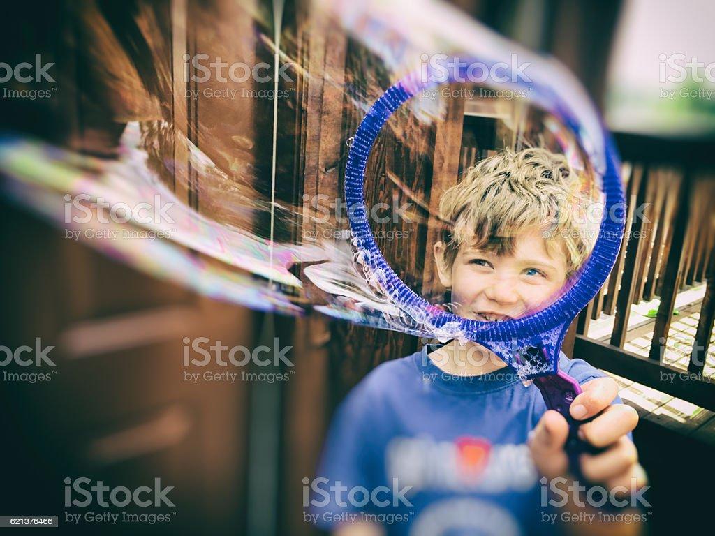 Child seeing through a bubble stock photo