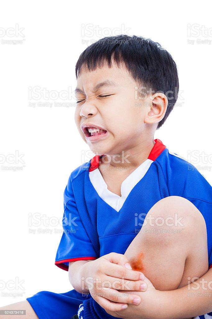 Criança canela com um Equimose e dolorosa - foto de acervo