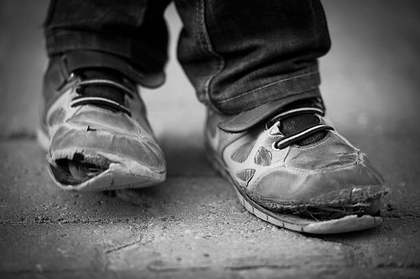 child shoes - poverty stock pictures, royalty-free photos & images