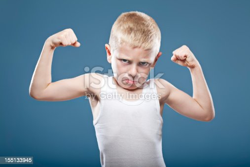 istock Child showing his muscles 155133945