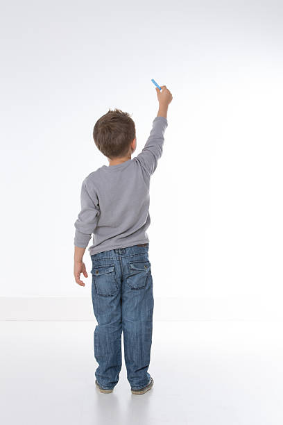 child shown from behind stock photo