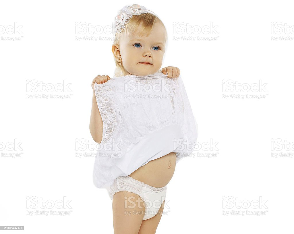 Child shows tummy stock photo