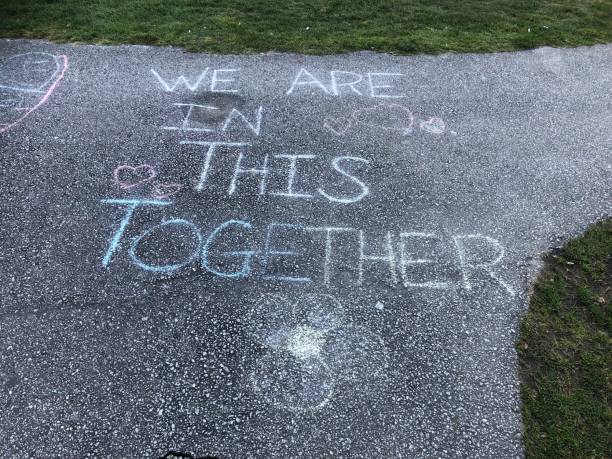 Child Sidewalk message Covid19 Sidewalk message chalk drawing stock pictures, royalty-free photos & images