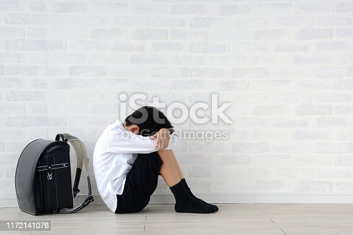 istock Child sitting alone in living room 1172141076