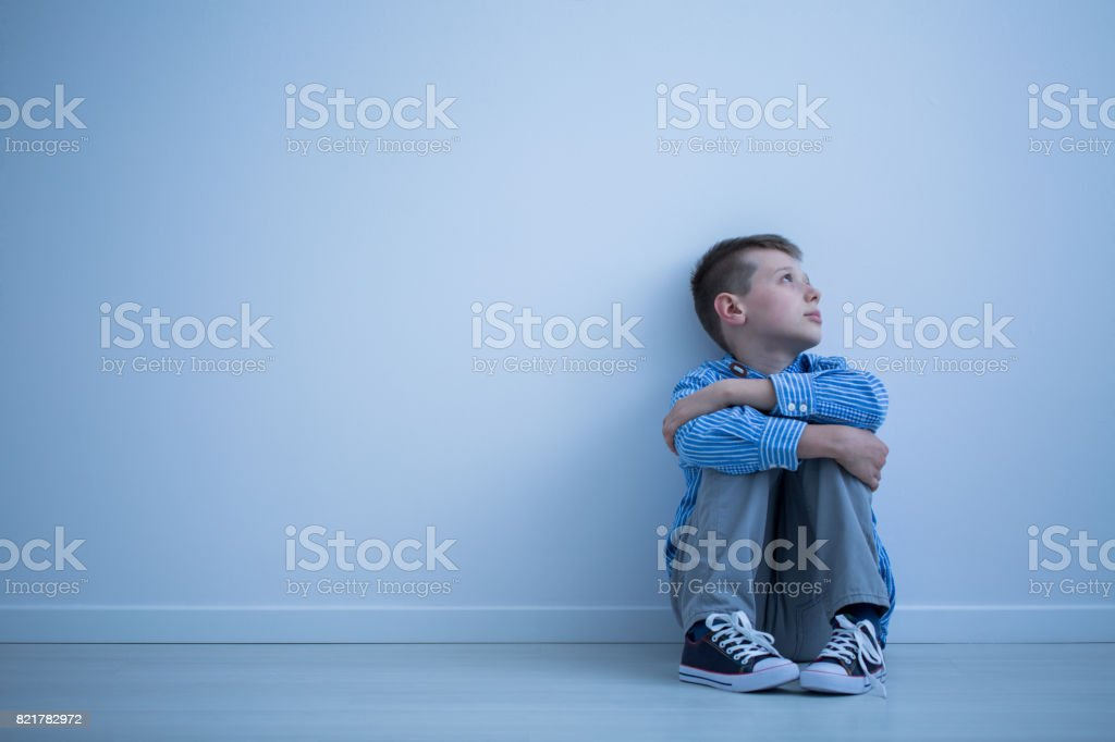 Child sitting on a floor stock photo