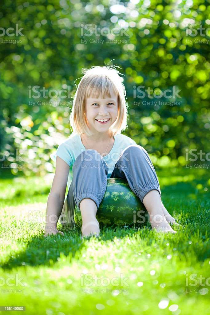 Child sitting on watermelon royalty-free stock photo