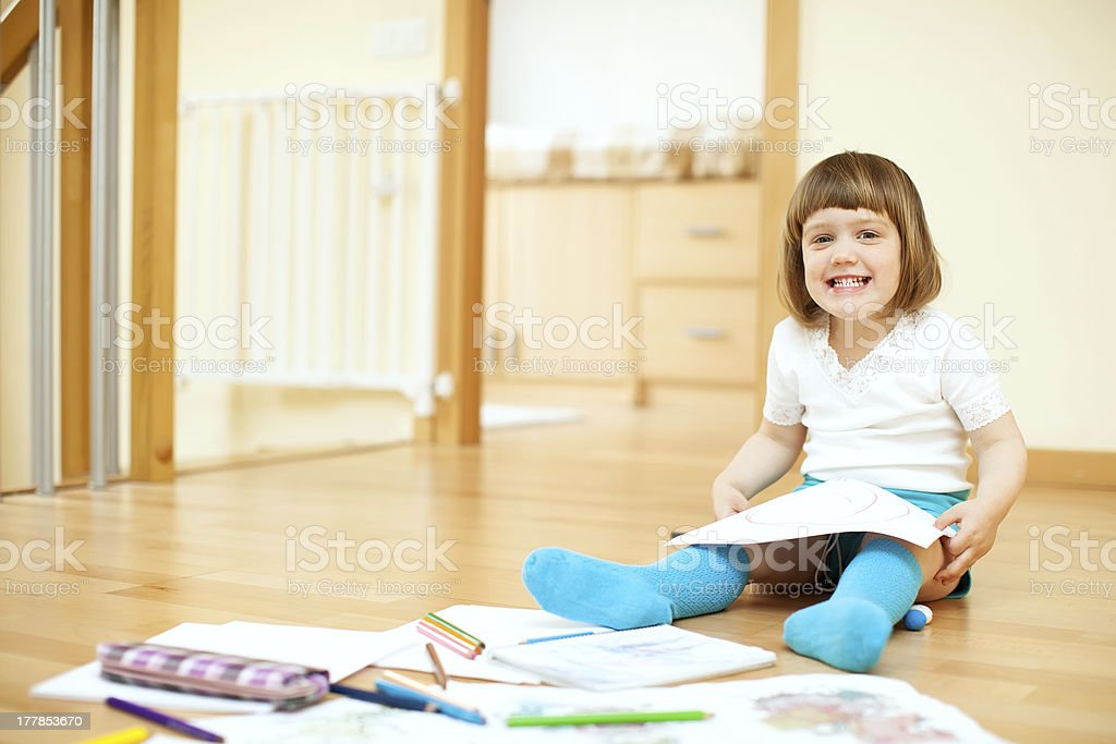 child sketching on paper in  interior royalty-free stock photo