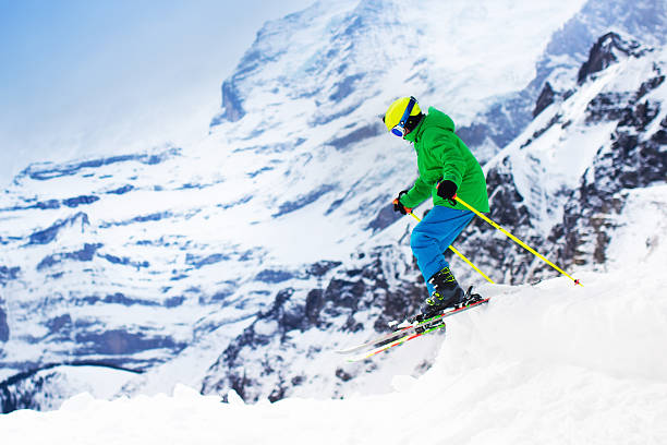 child skiing in the mountains - winter austria train bildbanksfoton och bilder