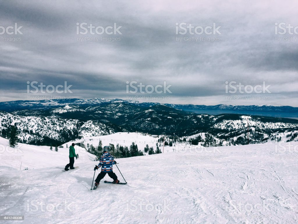 Child skis with father stock photo