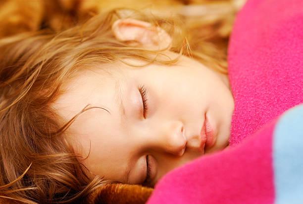 Child sleeps stock photo