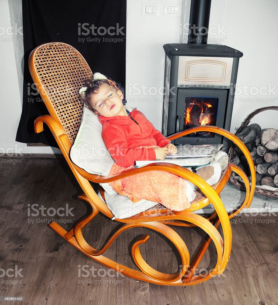 Picture of: Child Slipping In A Wooden Rocking Chair Stock Photo Download Image Now Istock
