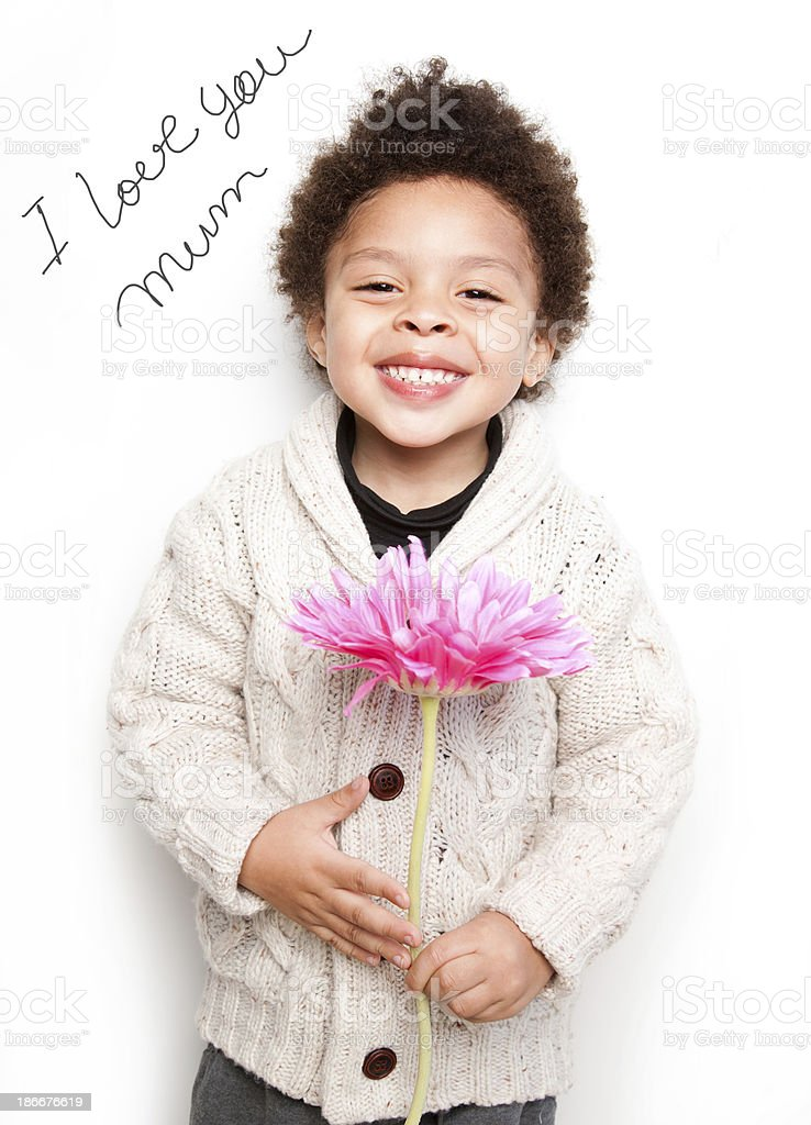 Child smiling with pink flower and love mum message royalty-free stock photo