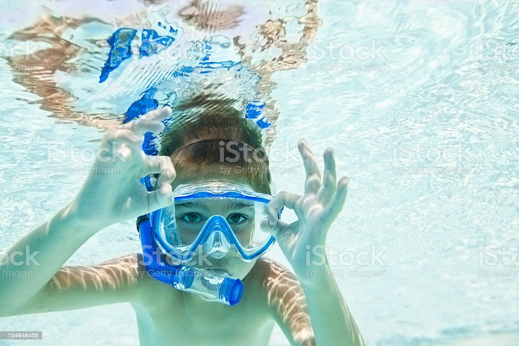 Child snorkeling in swimming pool royalty-free stock photo