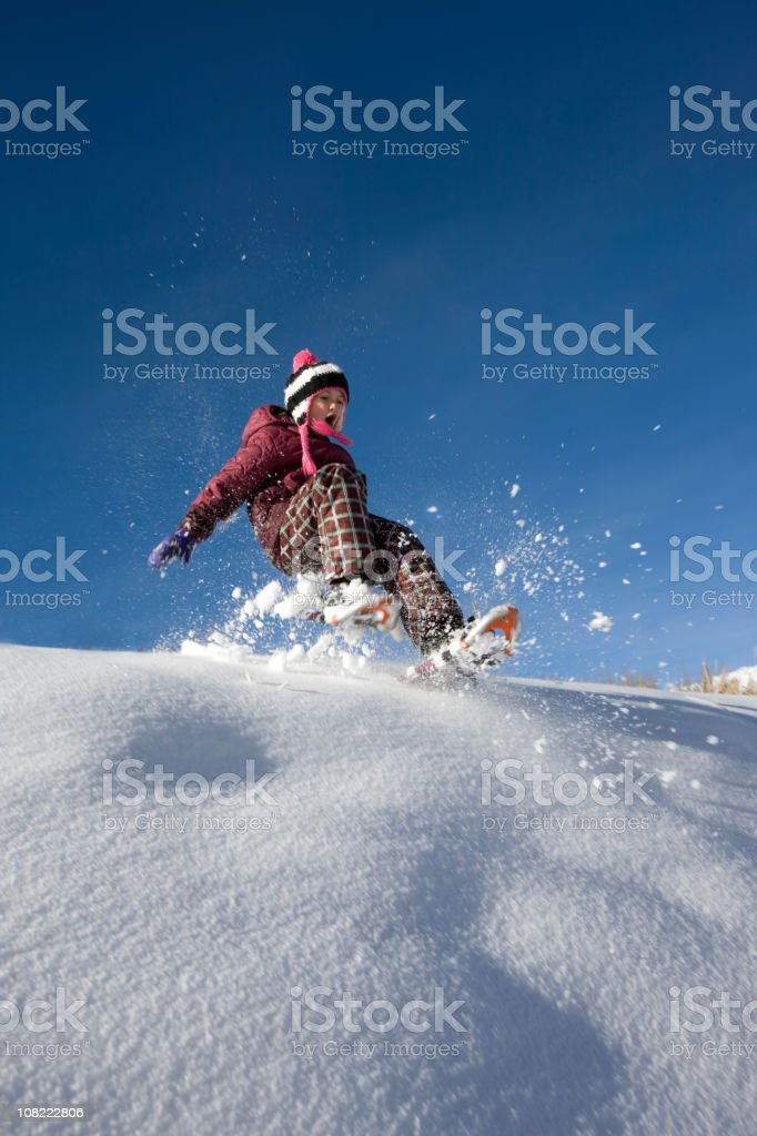 Child snowshoeing royalty-free stock photo