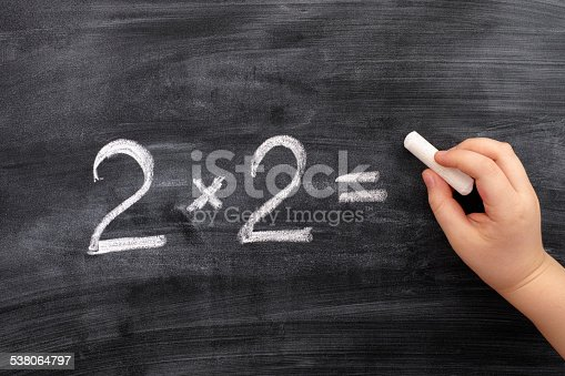 161754253istockphoto Child solving math problem on the blackboard 538064797