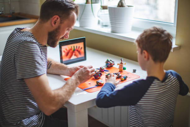 Child spending time at home during quarantine stock photo