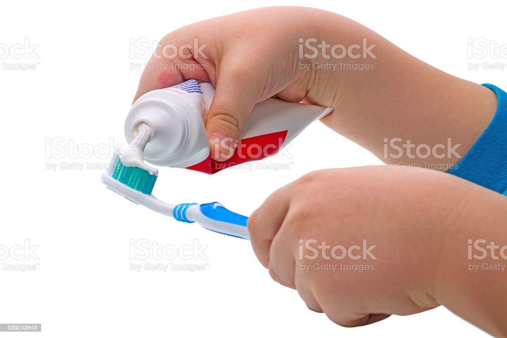 Child  squeezes the toothpaste stock photo