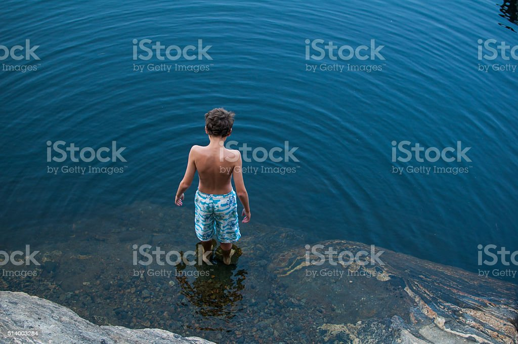 child standing in a lake royalty-free stock photo