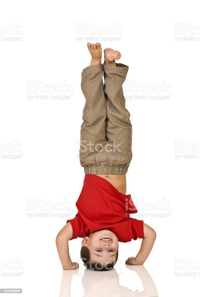 child standing on his arms stock photo